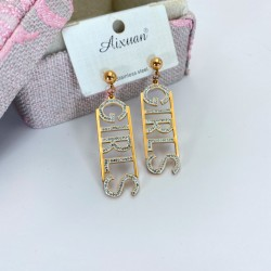 Letters with diamond earrings